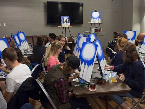 group of students having a paint night