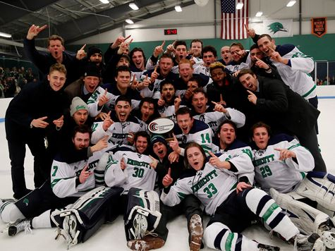 picture of mens hockey team on ice after victory