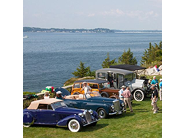 Four cars lined up at Concours D'Elegance along the Endicott College coastline