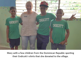 Mary with a few kids from the Dominican Republic sporting their Endicott t-shirts
