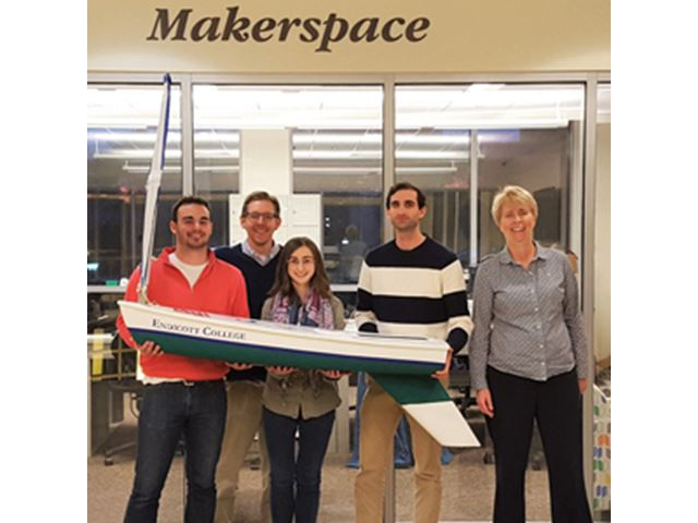 Makerspace staff with five-foot sailboat