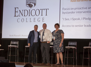 Endicott College accepts award on stage