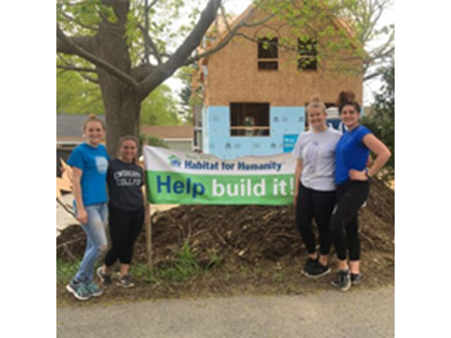 Endicott College students volunteering